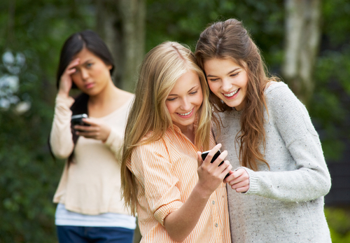 girls cyberbullying another